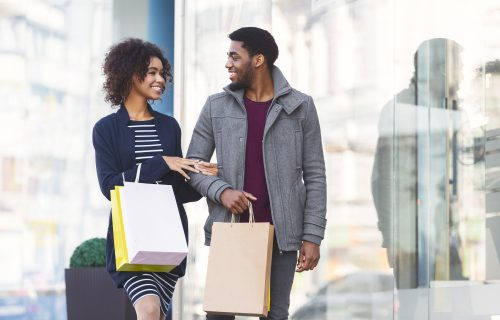 Happy black couple in love making shopping on weekend